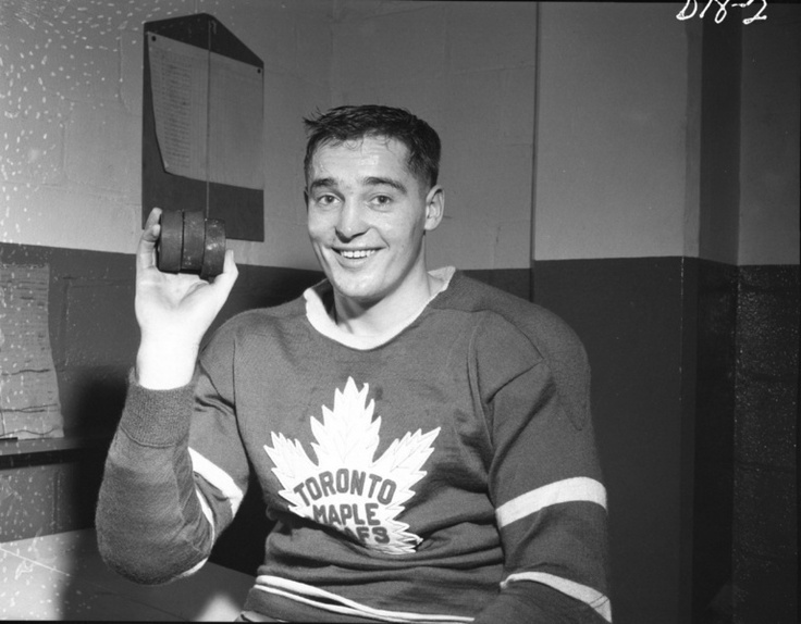Frank Mahovlich holds up the three pucks from his hat trick scored on Dec. 25, 1957 at Maple Leaf Gardens. The Toronto Maple Leafs beat the Montreal Canadiens 5-4 on a rare Christmas night game. (HHOF/Images on Ice)