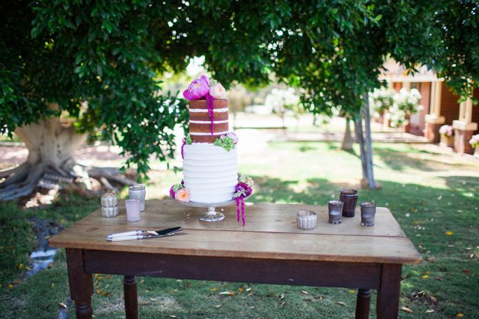 botanical beauty styled shoot   outdoor wedding   inspiration   private property   perth   western australia   furniture hire   wedding ceremony   long table dining   spring   wedding stylist   blue suit   bow tie   pink  peony cake topper   naked cake   garden wedding   collaboration   Featured on First Comes Love with images by Amelia Clair Photography