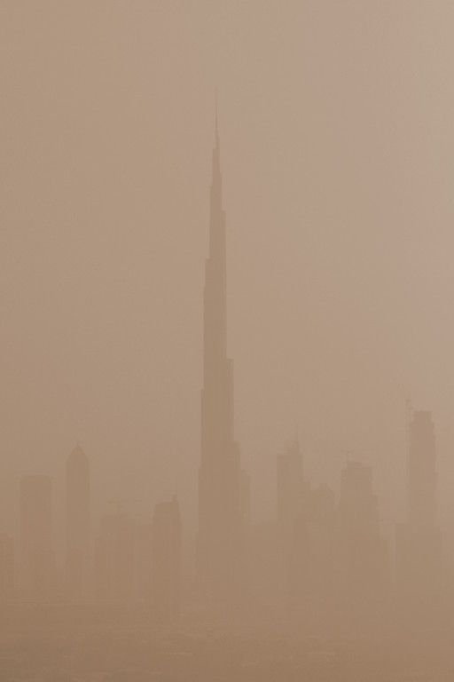 Dust storm covers the Burj Khalifa.  Built between 2004 and 2009 it is the tallest artificial structure in the world, standing at 829.8 m (2,722 ft). Dubai, UAE.