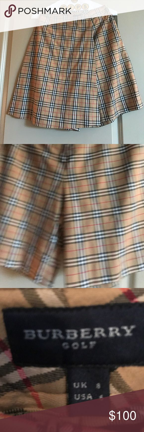 Burberry skort sz 6 Adorable Burberry skort Just freshly dry cleaned. Worn very few times. In fabulous condition.  Photo makes it look wrinkled but it is not. Just dry cleaned. Burberry Shorts Skorts