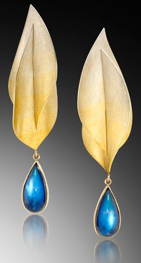 """2013 MJSA Vision Award 1st Place Professional Design Excellence, and 1st Place, Gold  Adam Neeley, Adam Neeley Fine Art Jewelry Inc., Laguna Beach, CA. """"Spectra"""" earrings transition seamlessly through seven gold colors, from rich yellow to white, and feature the adularescence of rainbow moonstones. (Adularescence, a milky bluish luster or glow, is found most notably when looking at gemstones such as moonstone. It is an optical phenomenon that exists only in the presence of light.)"""