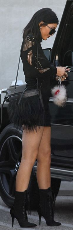 Kylie Jenner: Purse – 3.1 Phillip Lim  Dress – Alexander McQueen  Key Chain – Fendi  Sunglasses – Porsche  Shoes – Giuseppe Zanotti X Balmain