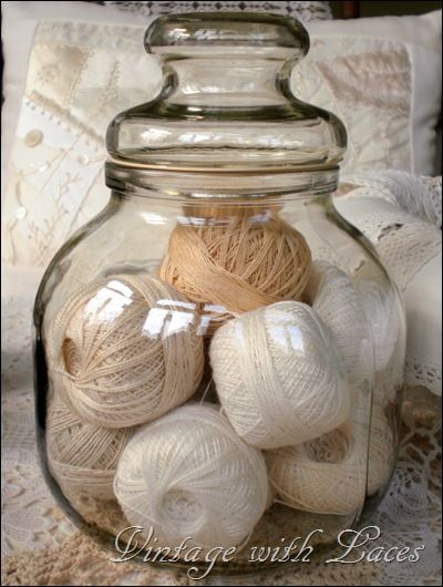 Candy jar filled with balls of crochet thread...By:vintagewithlaces. Perhaps on a bookcase...maybe that space ontop of my kitchen cabinets no one ever knows what to do with
