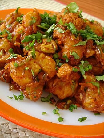 Gobi Manchurian. Indo-Chinese food at its best -- fried, spicy cauliflower with ginger, garlic, chiles,other tangy spices.