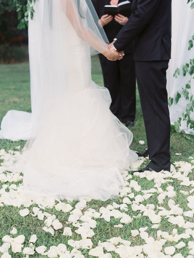 Pretty petal filled aisle: http://www.stylemepretty.com/2016/06/21/former-miss-nebraska-usa-shares-her-hometown-wedding/   Photography: Megan Pomeroy Photography - http://meganpomeroyphotography.com/