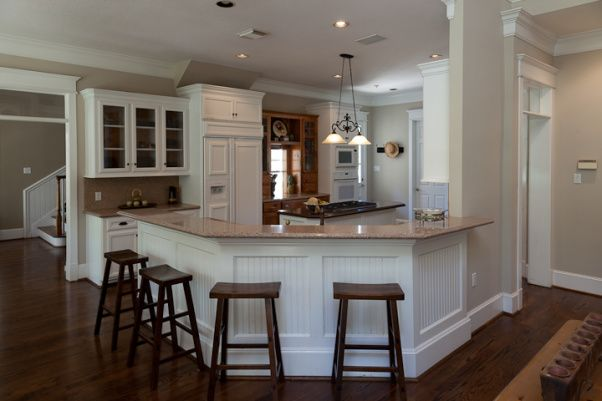 Southern charm kitchen, a southern charm kitchen, elegant country, a little french influence.  Silestone counters - Kona Beige and Coffee Brown on the island, farmhouse table, and white cabinets , the new lighter and airy P Pebble color makes the rooms feel bigger and more serene  , Kitchens Design