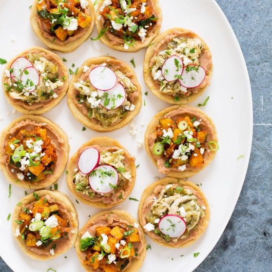 Sopes are small, savory tarts, traditionally served for dinner with endlessly variable fillings. We top our with Tomatillo Chicken, Radishes, and Queso Fresco.