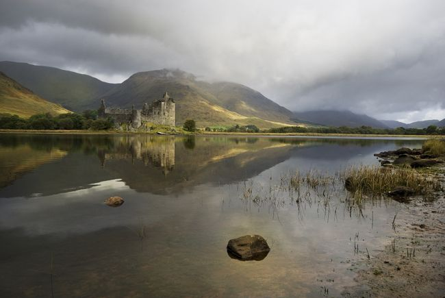 stunning landscape photograph of a scottish castle looking across ...