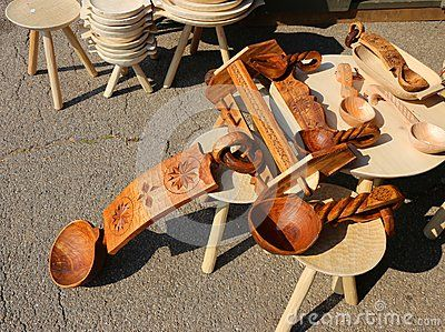 Wooden household objects handmade exposed for sale.