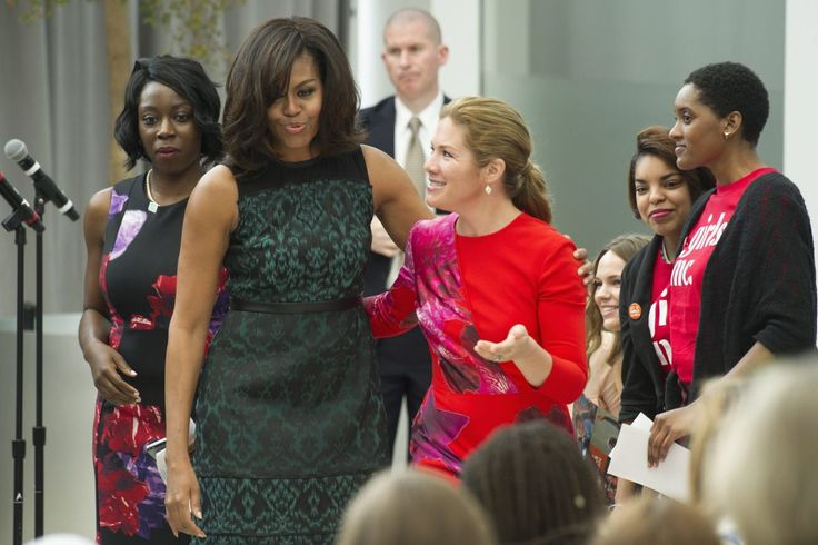 First lady Michelle Obama and Sophie Grégoire-Trudeau, wife of Prime Minister Justin Trudeau, walk to their chairs after the first lady lost her balance walking off of a stage while they participate in a program at the U.S. Institute of Peace in Washington, Thursday, March 10, 2016, to highlight Let Girls Learn efforts and raise awareness for global girl's education. (AP Photo/Cliff Owen)