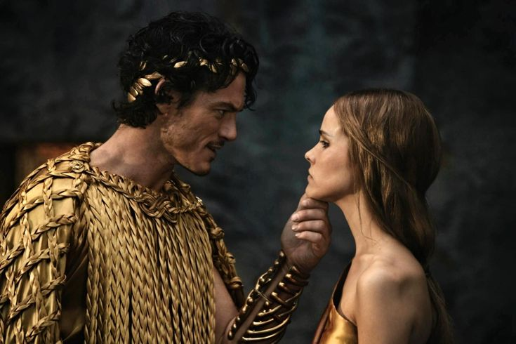 Luke Evans Immortals | Luke Evans stars as Zeus and Isabel Lucas stars as Athena in ...