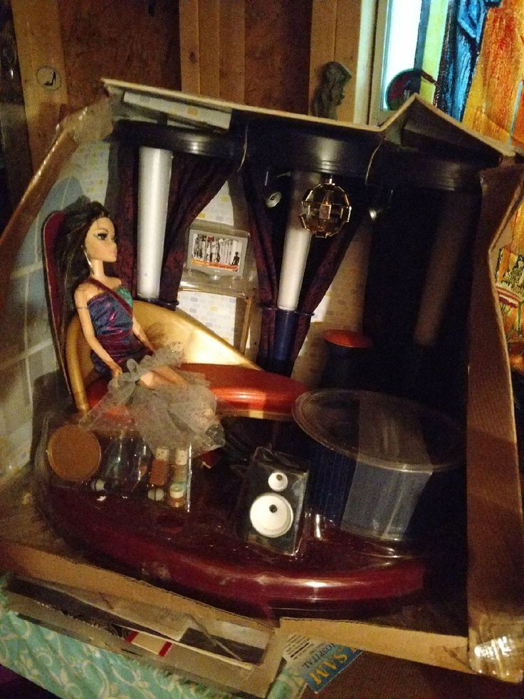 This is new never removed from the box but the Box got trashed it's still in its plastic the dolls never been removed it's working speaker and CD holder and it's my scene sound Lounge Scott working lights and it disco ball that turns curtains and a doll included