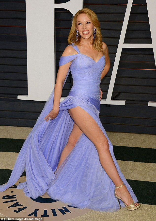 Cheeky! Kylie Minogue certainly made an entrance when she flashed her pert posterior upon ...