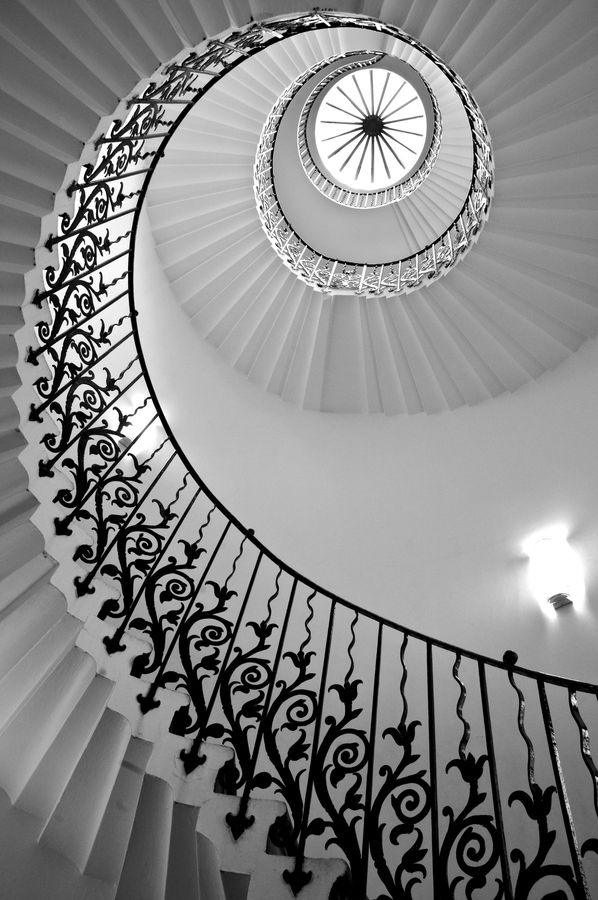 A black-and-white photograph of the staircase at the Queen's House, Greenwich. Patrick Baty (on Pinterest) was involved in its restoration.
