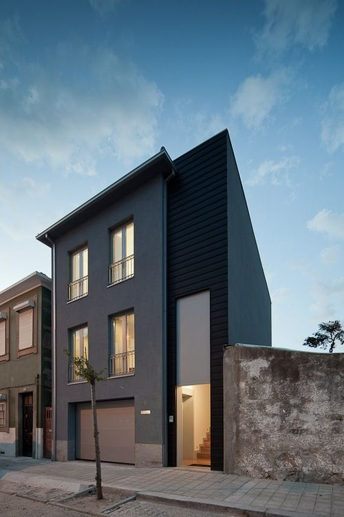 12 Modern House with Black Exteriors: The facade of Corpo Santo House designed by Rui Cerqueira Barros blends in a bit of the traditional with the window gate design, making for a nice compromise on a city street in Portugal.