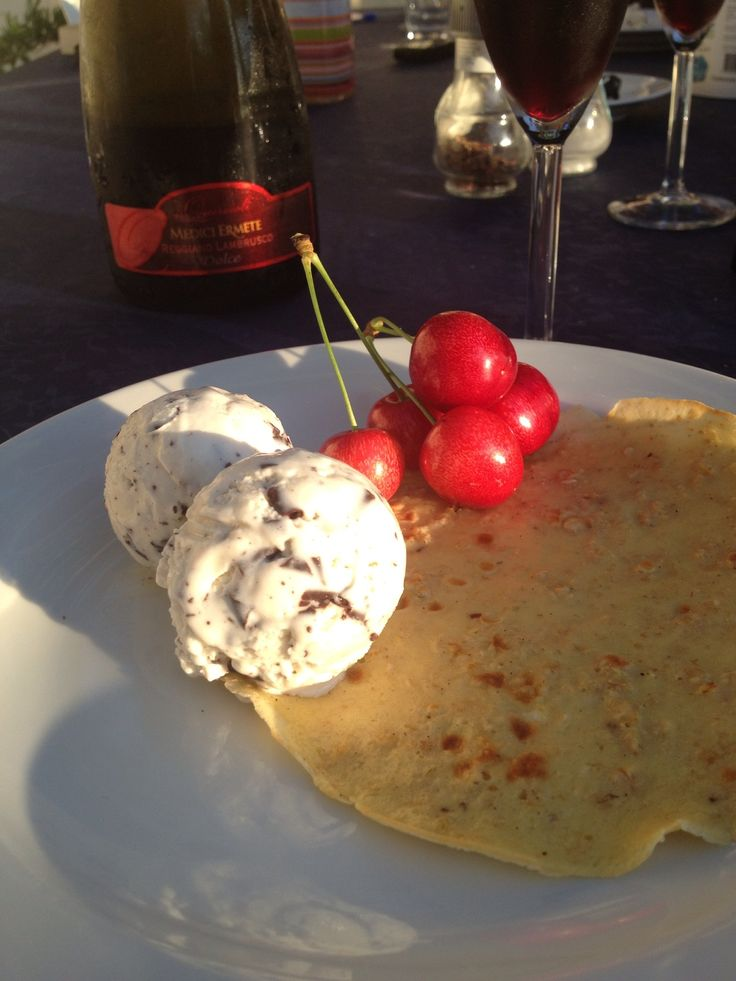 Pancakes made on a barbecue with ice creme and berries from my parents garden.