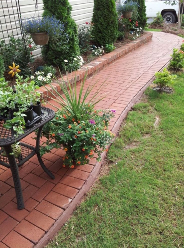 Pine Hall Brick walkway with planters by Charlotte Pavers