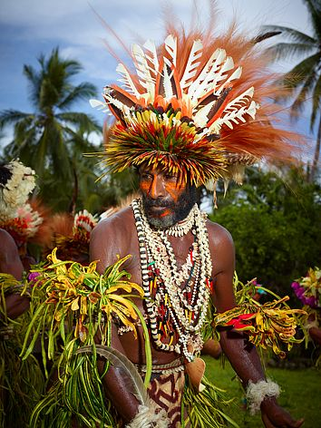 Papua New Guinea - decorated by croton leaves, bird of paradise feathers