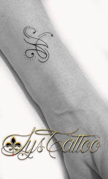 Tatouage Avant Bras Femme Une Lettre M Qui Se Transforme En 2 A