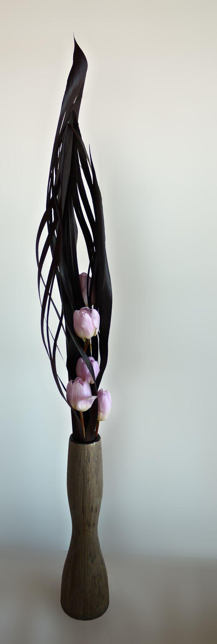 Pale lilac color tulips and cordyline leaves.  Ikebana Sogetsu advanced…