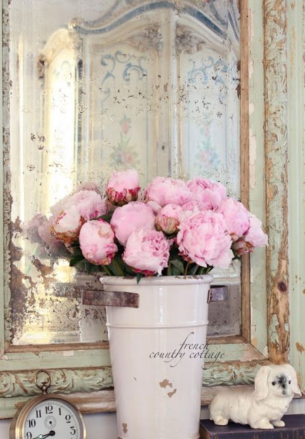 FRENCH COUNTRY COTTAGE: A little French Country, USE A  vintage metal tall container with flowers of choice place on round or oval mirror add votives all around it . use either mercury metal or frosted dyi on votive holders