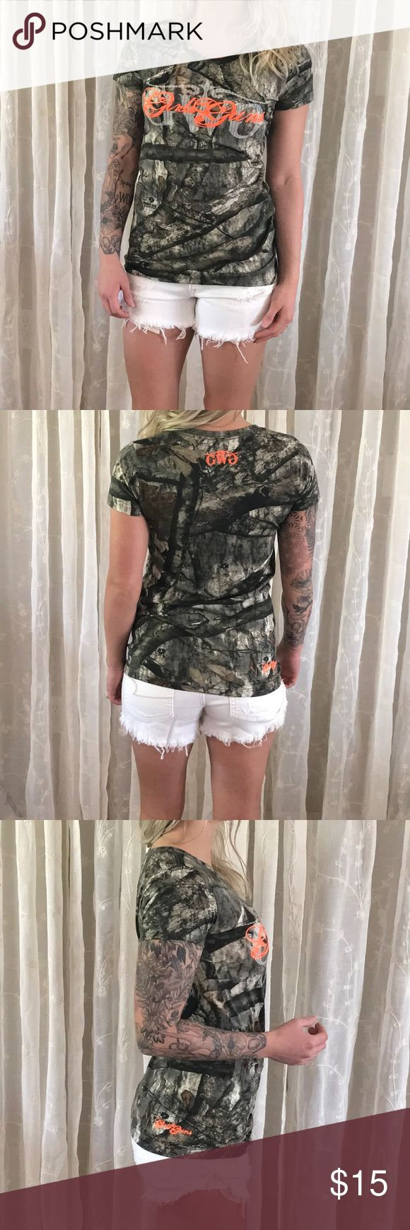 Girls with Guns Camo Tee Shirt Girls with guns |GWG| camouflage tee shirt. Scoop neck. Size small. Camo print is 'Mossy Oak Treestand'. Worn once, in great condition. Girls with Guns Tops Tees - Short Sleeve