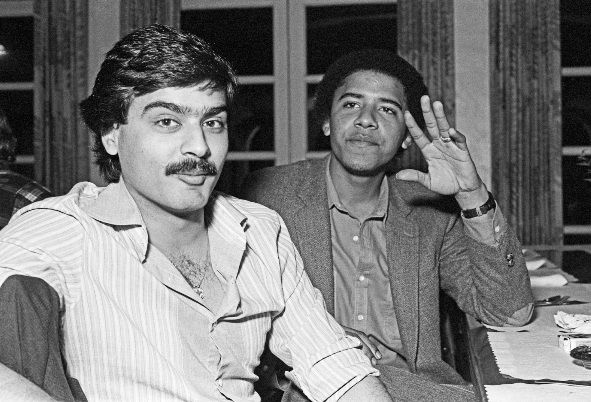 Obama continues to wear his Shahada ring stating in Arabic the first pillar of Islam 'There is no God but Allah'. Here with his Pakistani friend.