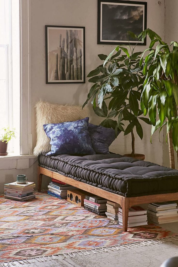 All About Daybeds: a daybed like this one would work really well to separate spaces in an open floor plan