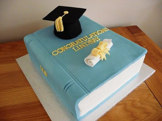 I like the idea of a book at the top of the cake with the cap on it.  You could play around with round and square cake shapes.