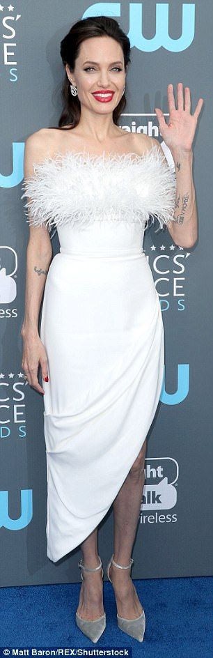 Looking divine! Angelina looked heavenly in her stunning all-white look that she teamed wi...