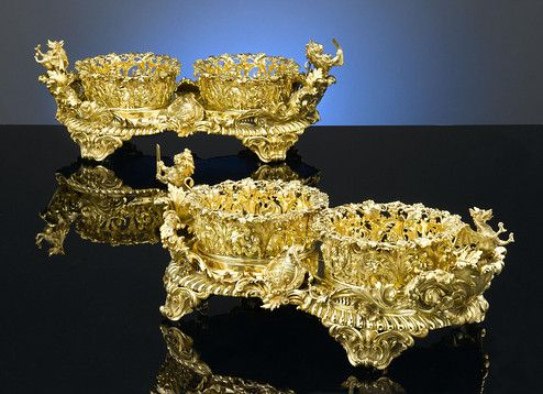 This pair of antique silver gilt double wine coaster for What is considered antique