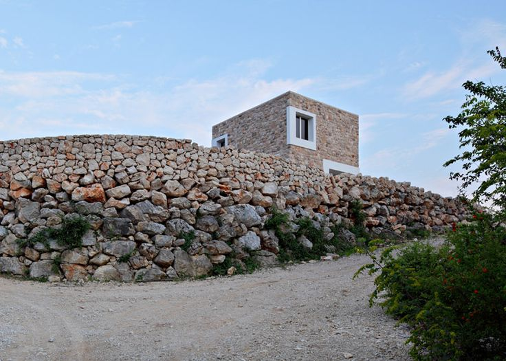 "Holiday ""village"" for an ex-footballer comprises seven cuboids with stone walls."