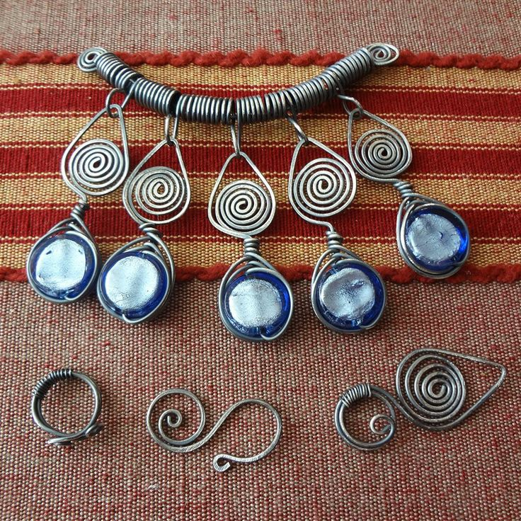 Dance of the Spirals necklace/ JewelryLessons.com -- When I look at this piece it reminds me of something ancient.