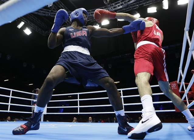 USA's Terrell Gausha fights Armenia's Andranik Hakobyan during a middle weight 75-kg preliminary boxing match at the 2012 Summer Olympics, Saturday, July 28, 2012