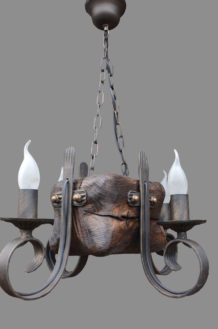 Модель: Кованая люстра ISFIR кубик (4 свечи) Производитель: ISFIR Тип: люстры, Люстры на цепи Количество источников света: 4-6 Материал: дерево, метал Цоколь: E14 20x15x15см высота от чашки 60см