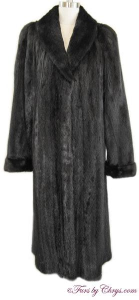 Long Ranch Mink Coat RM810; $1750; Excellent Condition; Size range: 4 - 8 Misses or Tall. This is a gorgeous genuine natural ranch mink fur coat. It features a large shawl collar, and adjustable turn-back cuffs. This mink coat is constructed of very superior mink pelts; the mink fur is very silky soft and very shiny and has wonderful drape. When you would like to feel luxurious and extra-special, you will reach for this spectacular fur coat!