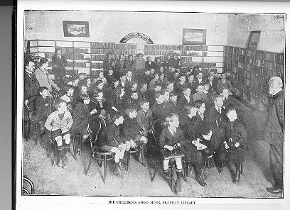 """PH 12671. Children's story hour, Prahran Library. The speaker was Rev T. Lord on """"Stories from Madagascar"""", c1925."""