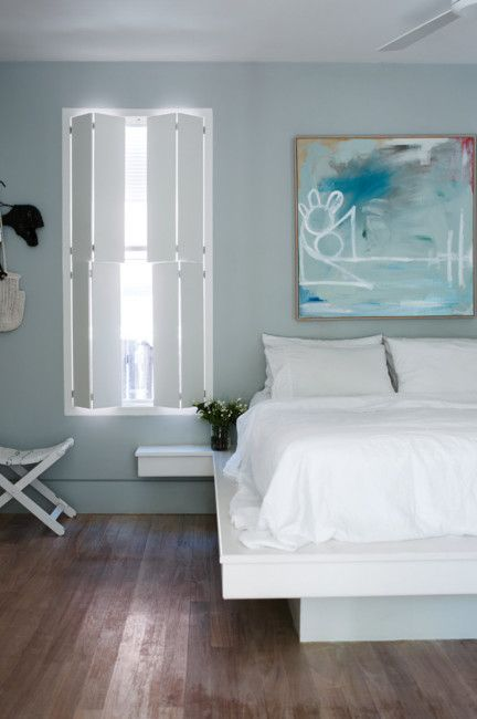 White bed covers and pale blue hues evoke a sense of serenity in the bedroom. Image by Prue Ruscoe for @homelife.com.au.