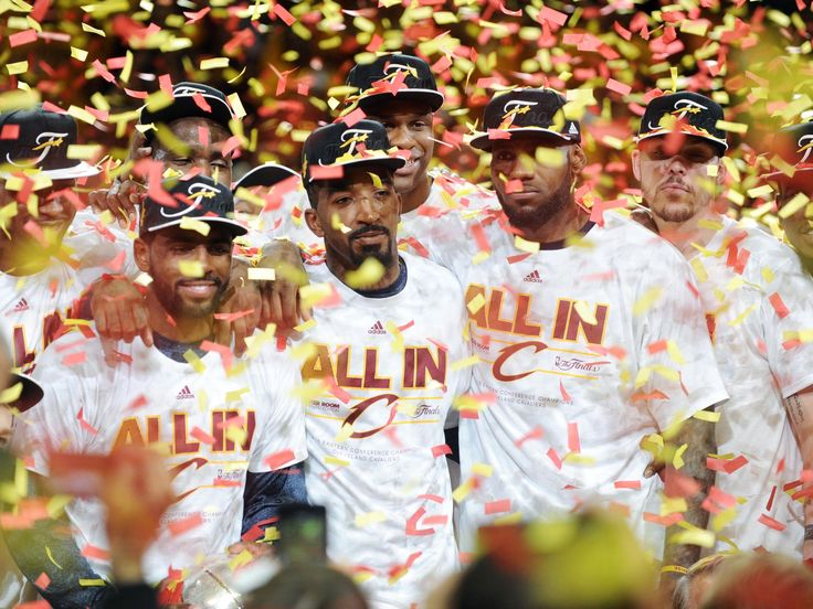 Cleveland Cavaliers guard Kyrie Irving (2), guard J.R. Smith (5) and forward LeBron James (23) celebrates beating the Atlanta Hawks in game four of the Eastern Conference Finals of the NBA Playoffs at Quicken Loans Arena.  Ken Blaze, USA TODAY Sports