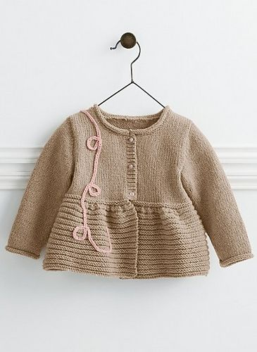 This extra-soft peplum cardigan is knitted in cashmere, and has a decorative crochet chain 'ribbon' for that personal touch.
