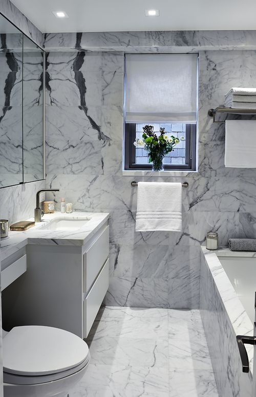 Bathroom in Statuary Marble by Katch I.D. Interiors
