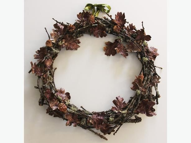 Wreath by Robert Amos and Emma Yardley: A Garry Oak theme, using twigs, lichen. acorn caps, leaves and glitter, florists wire and hot glue on a wire base. Most of the materials were gathered in their own front and back yards.