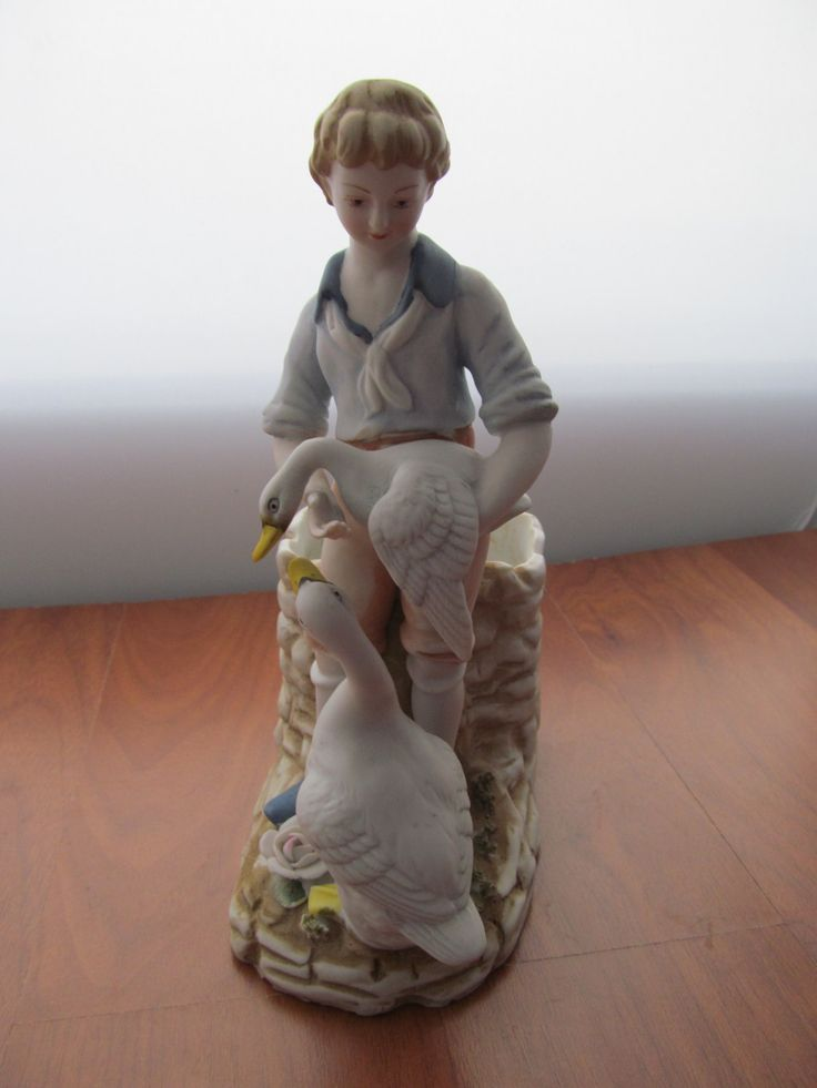 Rare HTF  Andrea by Sadek Boy Geese Well Planter 6486 Bisque Porcelain Figurine Detailed Boy holding goose Flowers and another goose at his feet He is standing in front of a well ( 2.75 Deep )  8 H x 5 D x 3 W  1.25 lb
