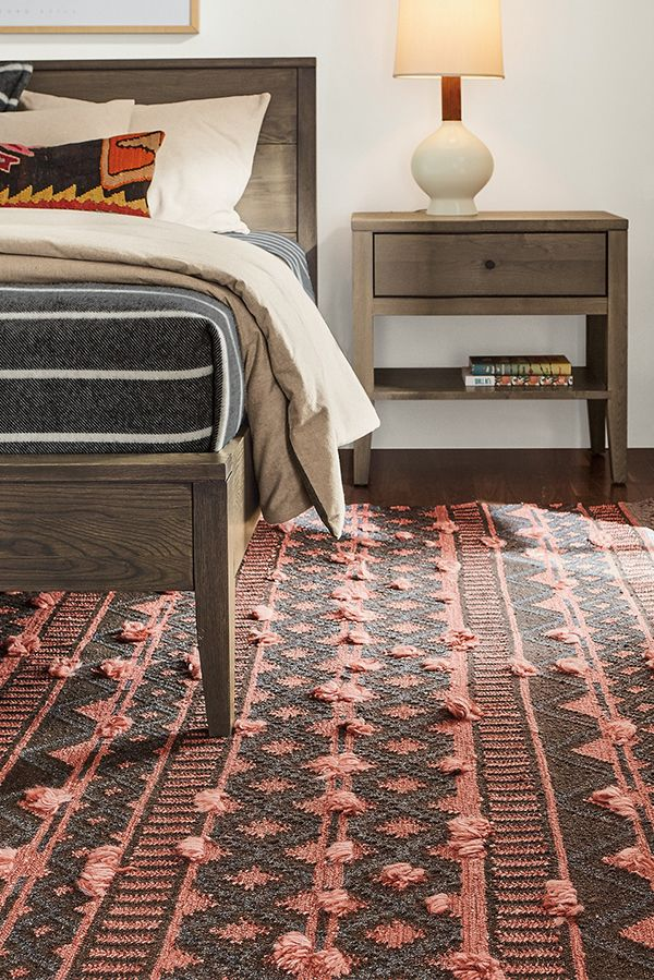 Ember puts a modern twist on traditional flat-weave designs by adding tufts of shag across the rug.