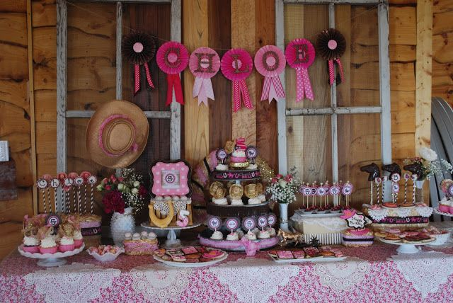 This Cowgirl Princess Party is a perfect combination of cowgirl and princess. Great touches and decoration ideas.The mini cowboy hats on the cupcakes are sweet!