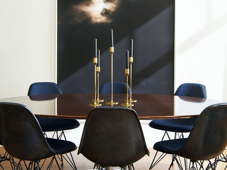 Just off the living room of this New York apartment by Gachot Studios, an arresting supersized photograph by Wolfgang Tillmans plays a starring role in the dining area. (A custom picture light from Modulightor hovers just above it.) Black Eames chairs, a vintage rosewood table by Knoll from Naga, and streamlined candleholders from The Line all add up to unfussy elegance.