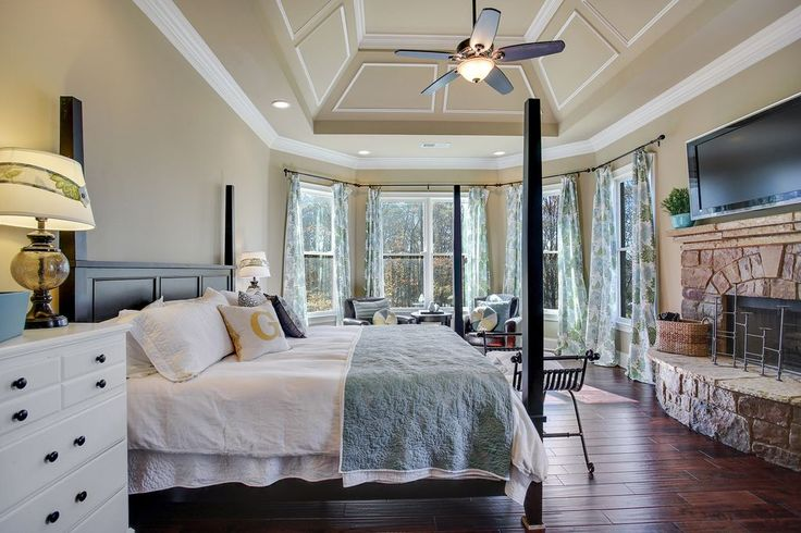Traditional Master Bedroom with Cathedral ceiling & Ceiling fan in Canton…