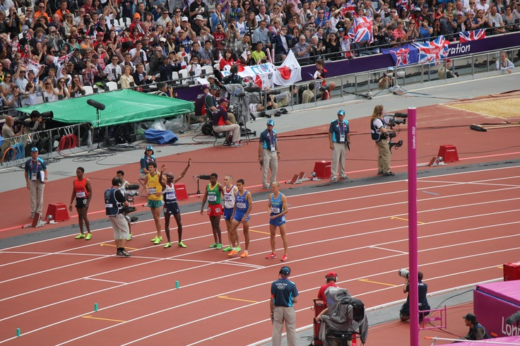 Mo Farah (waving), about to compete in his round for the 5000m qualifying, Wednesday 8th August 2012