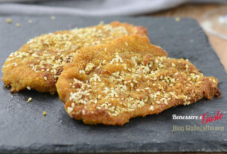 Pollo con panatura al curry e sesamo, cotolette gustose e leggere cotte forno, senza grassi, ricetta secondo piatto facile e veloce