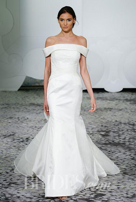 Brides.com: . Bateau neckline double-faced duchesse satin with lattice tulle and organza train Rivini by Rita Vinieris